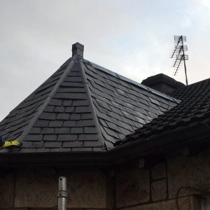 Slated dormer replaced with grey Marley plain tiles.